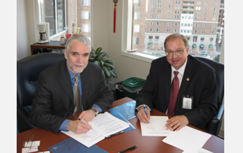Photo of Tim Killeen of NSF and Rick Fritz of AAPG signing new agreement.