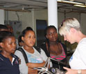 Photo of oceanographer Lisa Beal showing schoolchildren a current meter.
