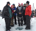 I�upiat students sampling water on the frozen Kaktovik Lagoon, Alaska.
