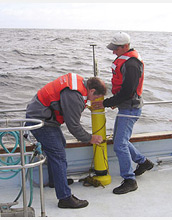 Photo of scientists testing an Apex float with a nitrate sensor in Monterey Bay, Calif.