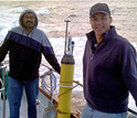 Photo of Ken Johnson and another scientist with an Apex float going for a test dive in Monterey Bay.