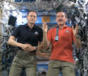 astronauts on space station with microphone