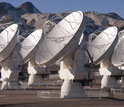 Screen showing array of satellite dishes at the ALMA site.