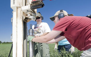 Researchers collecting soil cores to determine carbon storage at the LTER site.