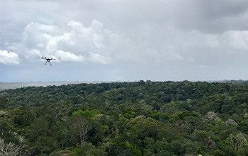 a drone flies toward a rainstorm in the Amazon