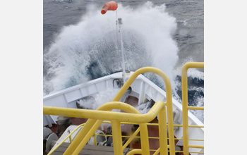 Photo of the JOIDES Resolution encountering rough seas during the transit to Antarctica.