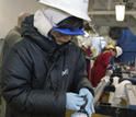 Photo of Saiko Sugisaki preparing a core for sampling.