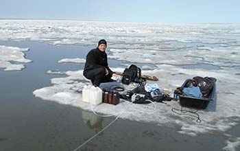 researcher James McClelland sampling water