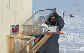 Scientist conductiong a snow-chamber experiment