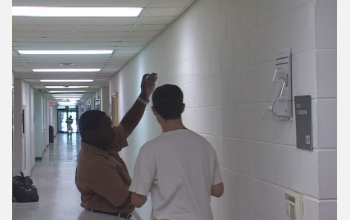 Two students from David Snider's combined art-engineering course trace perspective lines.