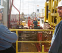 Photo of co-chief scientists Donna Blackman and Alistair Harding looking across the rig floor.