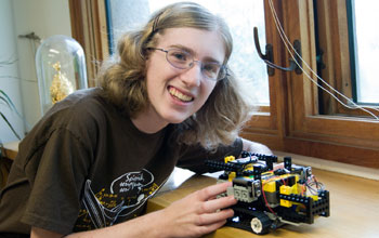 Photo of Anna Kornfeld Simpson with her robot