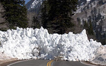 Photo of pile of snow from avalanche blocking Utah's highway 210 is avalanche.