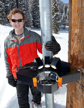 Photo of atmospheric scientist Tim Garrett using instruments to study snow.