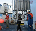 Photo showing deployment of an instrument to sample seawater at different depths.
