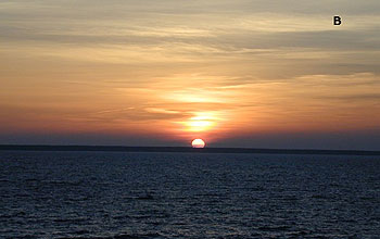 "A picture of the setting sun off the coast of Estonia and the letter ""B."""
