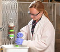 Researcher conducting experiments in a lab.