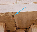 Close up photo of blocks with an arrow pointing to a cavity.