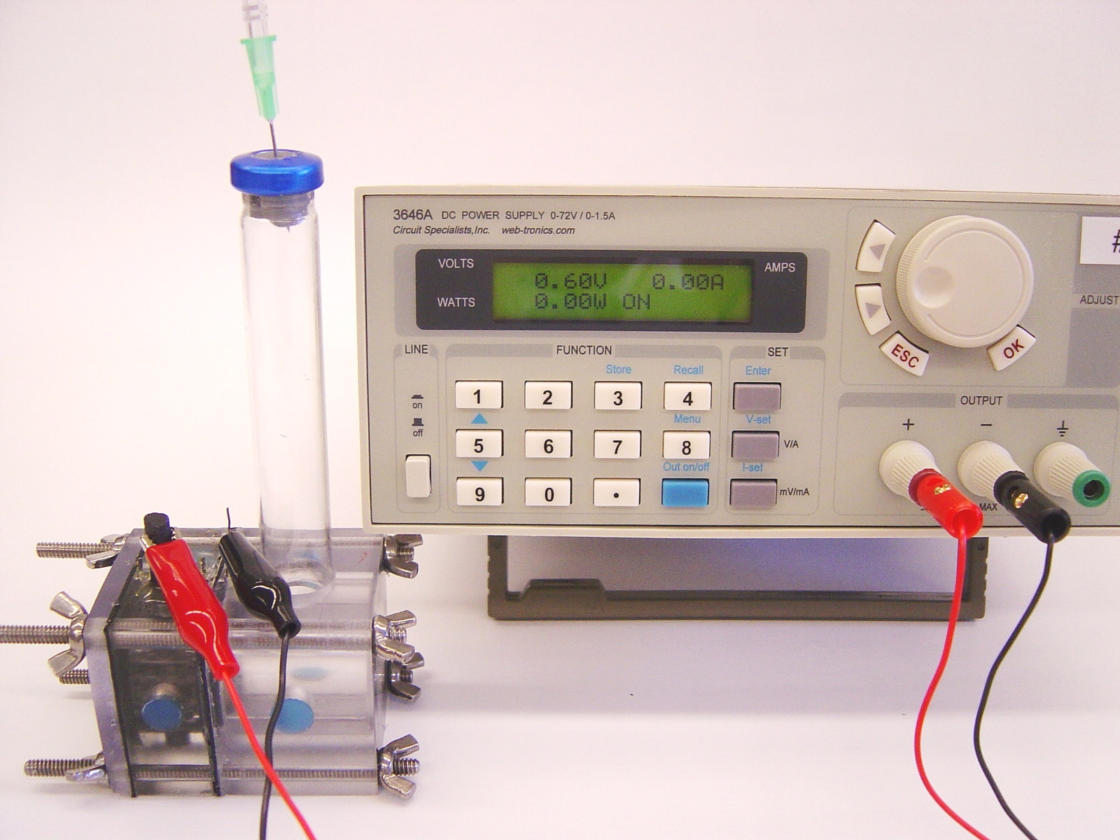 A microbial electrolysis cell (MEC) shown with a power source used to boost bacterial coltage.