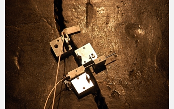 A close-up view of the MicroStrain NANO-DVRT wireless sensors clamped to the Liberty Bell.