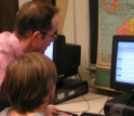 Teacher Pete DiNardo helps his students research Ben Franklin using ben.clusty.com test version