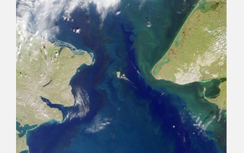Satellite image showing the Bering Strait with U.S. on the right and Russia on the left.