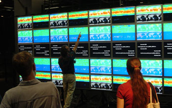 Photo of UC Irvine's HIperWall system measuring 23 x 9 feet with 50 flat-panel tiles.