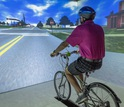 Adult on a stationary bike in a virtual envrionment