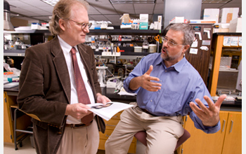 Photo of Jonathan Arnold and Heinz-Bernd Schuttler discussing their work on biological clocks.