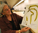 Curator Kathy Ann Miller looks at seaweed collected along the coast of Washington.