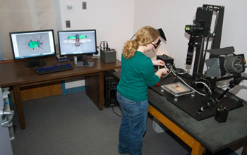 Photo of a researcher taking a high-quality image of a specimen.