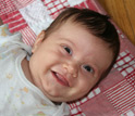 Photo of a smiling baby.