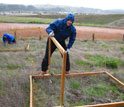 Photo of scientist David Hooper of Western Washington University conducting grassland research.