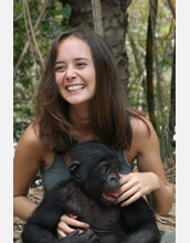 Photo of Duke University researcher Vanessa Woods with a bonobo in the field.