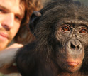 Photo of Duke University anthropologist Brian Hare with one of his bonobo subjects.