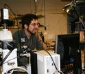 Ed Boyden with a computer and equipment in his office