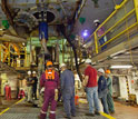 Photo of scientists and engineers beneath the rig floor.
