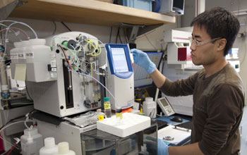 Photo of a researcher conducting a geochemical analysis of the water in ocean-floor sediments.