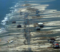 Aerial image  showing houses and flooded land on Dauphin Island, Ala.,