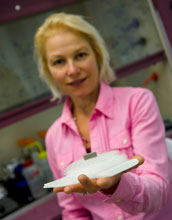 Photo of Caltech materials science expert Julia Greer holding micro-lattice ultralight metal.