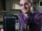 Grad student in laboratory with his laptop-size invention, the Mini-Z