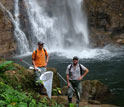 Photo of Marcus Kronforst (left) and Ryan Hill (right) hunting for butterflies in Ecuador.