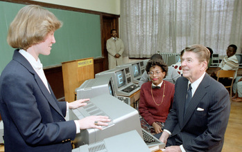 President Ronald Reagan with teacher and students in computer class