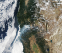 satelite photo from August 2014 showing large wildfires burning in Northern California.