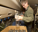 Geoscientist Ralph Keeling replaces used flasks filled with air samples