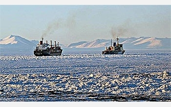 The icebreaker Krasin escorts the cargo ship American Tern out of McMurdo Sound.