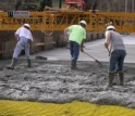 Workers covered the composites with concrete in the final steps of the bridge renovation