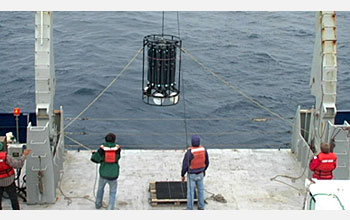University of Hawaii researchers use taglines to control sway of sampling device entering water.