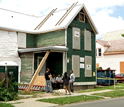 Photo of a house in inner-City Buffalo being restored by good-paying green jobs.