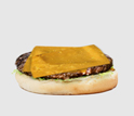 Image of the bottom bun, hamburger and a slice of melted cheese.